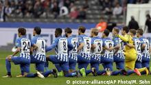 Players of Berlin kneel down prior to the German Bundesliga soccer match between Hertha BSC Berlin and FC Schalke 04 in Berlin, Germany, Saturday, Oct. 14, 2017. Hertha Berlin nodded to social struggles in the United States by kneeling before its Bundesliga game at home to Schalke on Saturday. Hertha's starting lineup linked arms and took a knee on the pitch, while coaching staff, officials and substitutes took a knee off it. The action was intended to show solidarity with NFL players who have been demonstrating against discrimination in the US by kneeling, sitting or locking arms through the anthem before games. (AP Photo/Michael Sohn) |