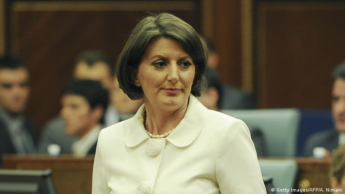 Atifete Jahjaga wearing a white jacket and necklace