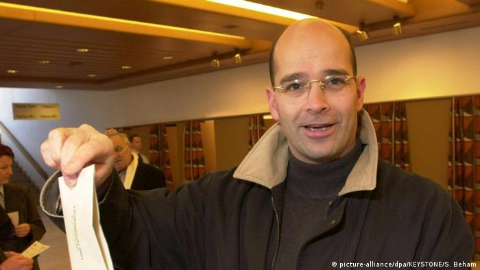A photo of Mario Frick voting in 2001