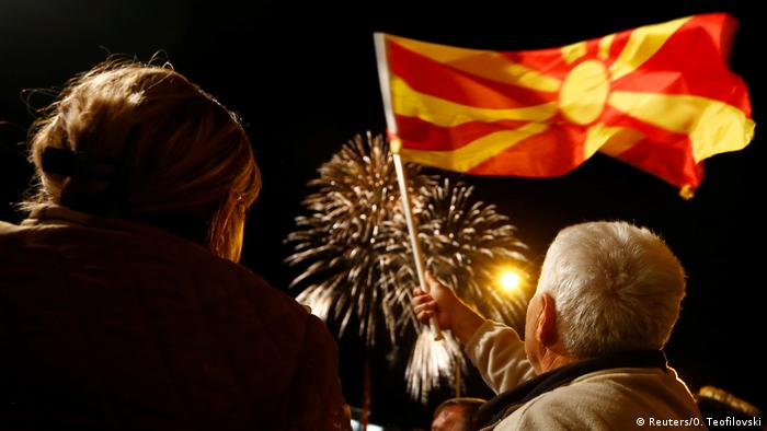 Supporters of the ruling Social Democratic Union of Macedonia wave a Macedonian flag during victory celebrations for the local elections