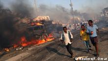 14.10.2017*** Civilians evacuate from the scene of an explosion in KM4 street in the Hodan district of Mogadishu, Somalia October 14, 2017. REUTERS/Feisal Omar TPX IMAGES OF THE DAY