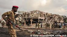 14.10.2017*** TOPSHOT - EDITORS NOTE: Graphic content / Somali soldiers patrol on the scene of the explosion of a truck bomb in the centre of Mogadishu, on October 15, 2017. A truck bomb exploded outside a hotel at a busy junction in Somalia's capital Mogadishu on October 14, 2017 causing widespread devastation that left at least 20 dead, with the toll likely to rise. / AFP PHOTO / Mohamed ABDIWAHAB (Photo credit should read MOHAMED ABDIWAHAB/AFP/Getty Images)