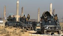 Iraqi forces drive past an oil production plant as they head towards the city of Kirkuk on October 16, 2017. / AFP PHOTO / AHMAD AL-RUBAYE (Photo credit should read AHMAD AL-RUBAYE/AFP/Getty Images)