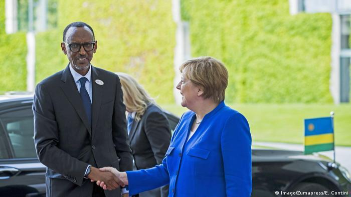 Rwandan President Paul Kagame being greeted in Berlin by German Chancellor Angela Merkel