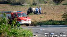 Police inspect the wreckage of a car bomb believed to have killed journalist and blogger Daphne Caruana Galizia close to her home in Bidnija, Malta? on October 16, 2017. The force of the blast broke her car into several pieces and catapulted the journalist's body into a nearby field, witnesses said. She leaves a husband and three sons. Caruana Galizia's death comes four months after Prime Minister Joseph Muscat's Labour Party won a resounding victory in a general election he called early as a result of scandals to which Caruana Galizia's allegations were central. / AFP PHOTO / STR / Malta OUT (Photo credit should read STR/AFP/Getty Images)