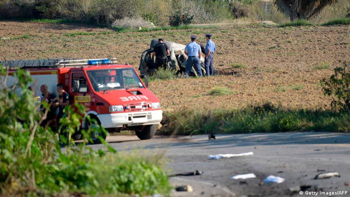 Police inspect the wreckage of a car bomb believed to have killed journalist and blogger Daphne Caruana Galizia close to her home in Bidnija, Malta