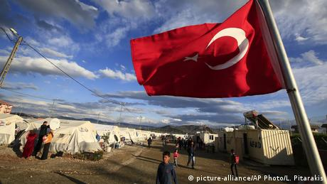 A Turkish flag waving on the border to Syria