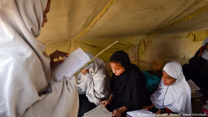 Afghan students attend an under tent class in Jalalabad, capital of Nangarhar province, Afghanistan