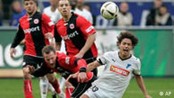 Hoffenheim and Frankfurt players struggle for the ball