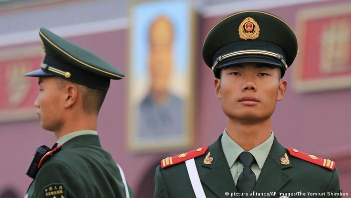 Police officers patrolling Tiananmen Square in Beijing