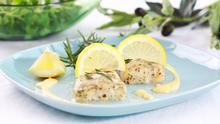 Baked hake with olive oil and rosemary