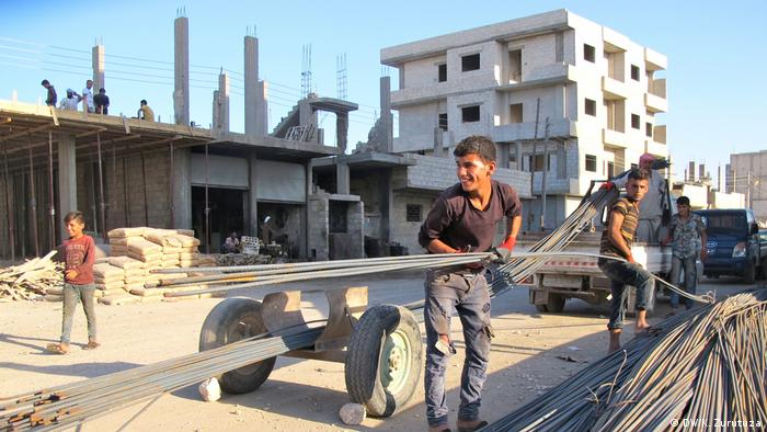 Construction work in downtown Kobani