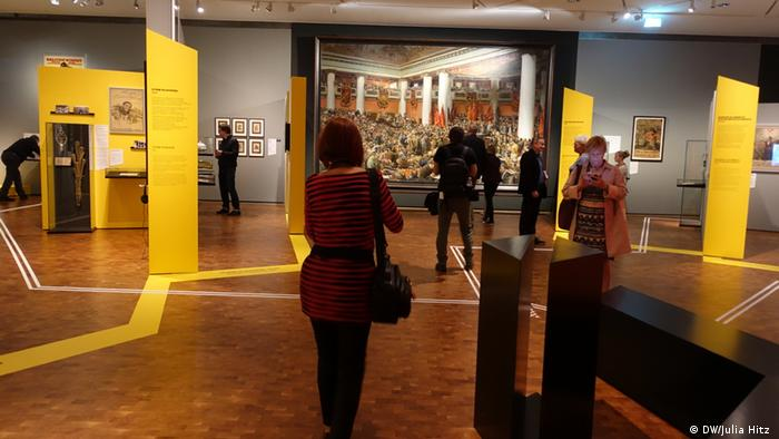 Yellow zig-zag on floor at the exhibition