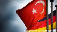 German and Turkish flags flying next to one another (Imago/Chromeorange/M. Schroeder)