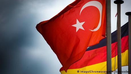 German and Turkish flags (Imago/Chromeorange/M. Schroeder)