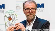 LONDON, Oct. 16, 2017 George Saunders poses with his book Lincoln in the Bardo during a photocall at the Royal Festival Hall in London, Britain, on Oct. 16, 2017, one day ahead of the announcement of the winning book of the 2017 Man Booker Prize. Six novelists have been shortlisted for the 2017 Man Booker Prize, a literary prize awarded for the best original novel in English |