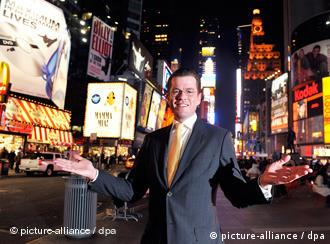German Economics Minister Karl-Theodor zu Guttenberg poses in Times Square, New York
