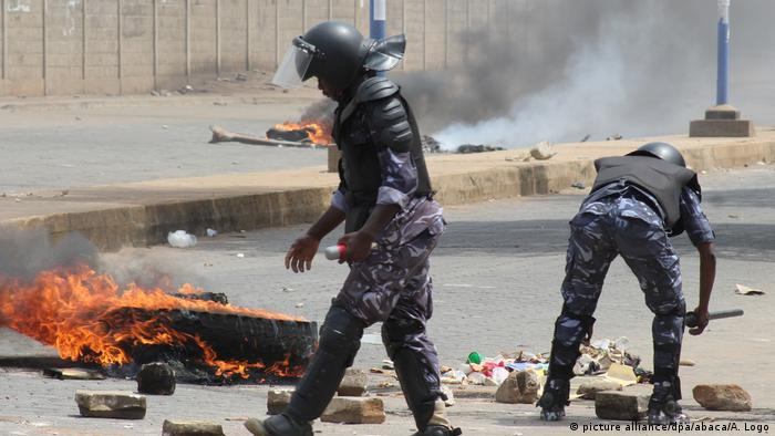 Security forces clear a blocked road after protesters staged a demonstration against President Gnassingbe in Lome
