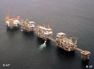 ** FILE ** A five-platform complex pumps crude off the coast of Cabinda, Angola's most prolific oil field in this Friday, July 12, 2002 file photo. Angola is joining OPEC, African oil exploration is booming and China is investing. The stampede for African oil has continued, even as militant attacks in some countries and precarious governments in others make returns uncertain. (AP Photo/Bruce Stanley, File)