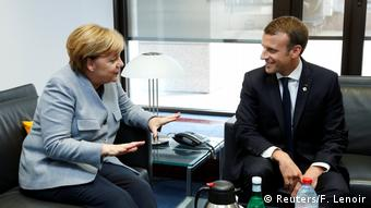 Markel and Macron sit in a room and talk
