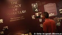 HAIFA, ISRAEL - JULY 14: A visitor learns about Bahá'u'lláh, the 19th century Persian founder of the Bahai faith, in the visitors' center in the Bahai gardens July 14, 2008 in the northern Israeli city of Haifa. The world spiritual center of the Bahai faith, whose devotees number less than six million worldwide, was declared a World Heritage Site by UNESCO last week. (Photo by David Silverman/Getty Images)