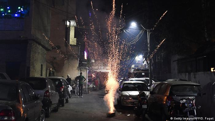 Indian people set off fireworks to celebrate the Diwali festival