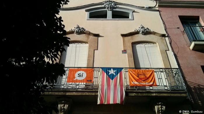 banners hanging from a balcony
