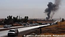 20.10.2017 +++ dpatopbilder - Rauch steigt am 20.10.2017 in Altin Köprü (Irak) im Rahmen eines Bombanangriffs irakischer Sicherheitskräfte auf, während sich kurdische Sicherheitskräfte von einem Kontrollpunkt zurückziehen. Zwischen irakischen Truppen und kurdischen Peschmerga-Kämpfern sind im Norden des Landes schwere Gefechte ausgebrochen. (zu dpa «Schwere Gefechte zwischen irakischen Truppen und Kurden» vom 20.10.2017) Foto: Khalid Mohammed/AP/dpa +++(c) dpa - Bildfunk+++ |