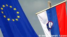KRANJSKA GORA, SLOVENIA - APRIL 30: The European and the Slovenian Flags are pictured together at the border between the Austrai, Slovenia and Italy as politicians mark Slovenia's accession to the European Union on April 30, 2004 in Kranjska Gora, Slovenia. The EU's Big Bang expansion brings in the Czech Republic, Estonia, Hungary, Latvia, Lithuania, Poland, Slovakia and Slovenia, along with Cyprus and Malta. (Photo by Giuseppe Cacace/Getty Images)
