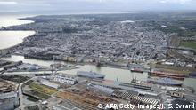 An aerial view shows the Vladivostok (L) and Sevastopol (R) warships, Mistral-class LHD amphibious vessels ordered by Russia from STX France in Saint-Nazaire, western France, on December 20, 2014. Russia will gladly take back the money it paid for French Mistral-class warships whose handover has been delayed by concerns over Moscow's role in the Ukraine crisis, deputy defence minister Yury Borisov has said. France, which is struggling economically, is faced with a tough decision: deliver the two mammoth warships to Russia and face the wrath of its NATO allies or end up with two vessels equipped for the Russian navy and pay the price and possibly heavy fines. AFP PHOTO / JEAN-SEBASTIEN EVRARD (Photo credit should read JEAN-SEBASTIEN EVRARD/AFP/Getty Images)