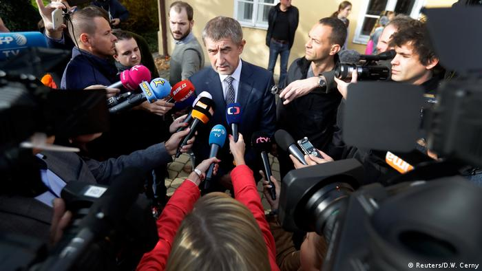 The leader of ANO party Andrej Babis speaks to the media after casting his vote in parliamentary elections in Prague