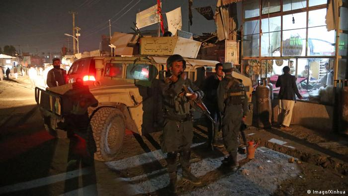 Afghan security forces secure the site of a Shiite mosque after a suicide bomb attack.