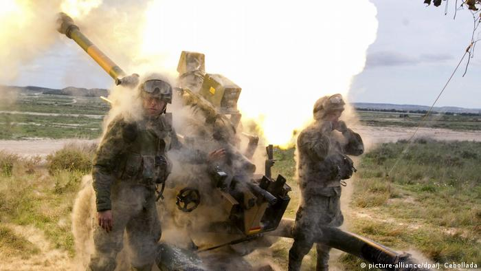 Spanish soldiers of the 7th Airborne Light Infantry Brigade 'Galicia' fire a howitzer Light Gun L118 in Zargoza, Spain, 19 April 2016, during maneuvers with other units from the Training Center 'San Gregorio' in preparation to NATO's Very High Readiness Joint Task Force (VJTF) within the NATO Response Force (NRF).