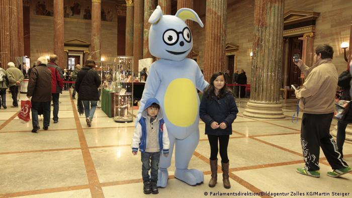 Austria's parliamentary mascot Lesko posing with some children