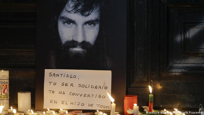 Photo of missing activist Santiago Maldonado surrounded by candles