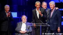 Benefit concert for victims of hurricanes in Texas attended by Barack Obama, Bill Clinton, George W. Bush, George H. W. Bush, and Jimmy Carter