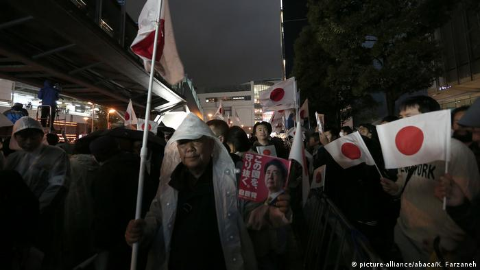 Supporters of the ruling Liberal Democratic Party braved inclement weather to join at a rally led by Prime Minister Shinzo Abe, the party's leader