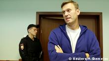 FILE PHOTO: Russian opposition leader Alexei Navalny attends an appeal against his jail for repeatedly violating laws governing the organisation of public meetings and rallies, at Moscow city court in Moscow