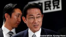 Japan's ruling Liberal Democratic Party (LDP) policy chief Fumio Kishida smiles as he arrives at the LDP headquarters in Tokyo, Japan, October 22, 2017. EUTERS/Kim Kyung-Hoon