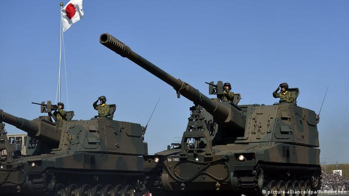 Artillery armored vehicles participate in an annual military parade