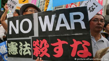 Protesters shout anti-government slogans, carrying placards that read: No war