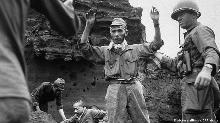 Japanese troops surrender to US Marine at Iwo Jima