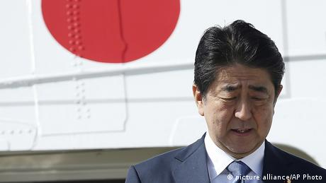 Japan's Prime Minister Shinzo disembarks from a plane