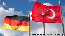 A German and Turkish flag wave side-by-side
