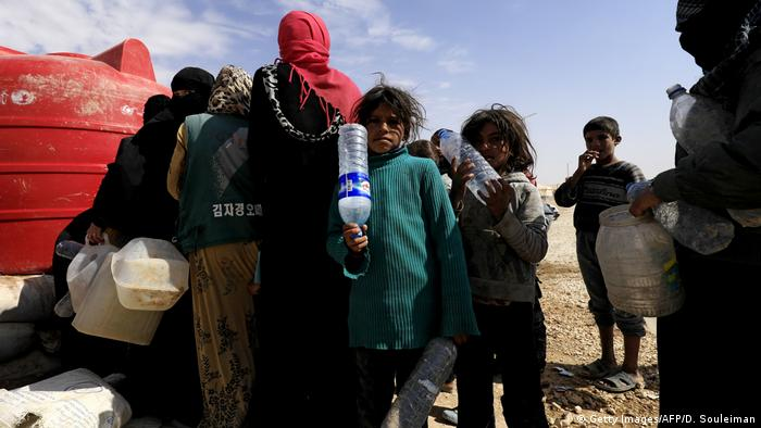 People wait in a line for water (Getty Images/AFP/D. Souleiman)
