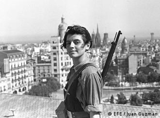 A young Republican fighter in Barcelona with a gun slung over her shoulder.