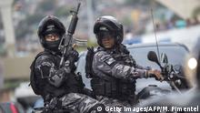 September 29, 2017*** PM militarized police personnel patrol Rocinha favela in Rio de Janeiro, Brazil on September 29, 2017. The 950 soldiers deployed last week at Rocinha favela, Rio's biggest, were withdrawn Friday once reached the objective of stabilizing the situation of violence created by the action of drug traffickers, the Brazilian Defence minister said. / AFP PHOTO / Mauro PIMENTEL (Photo credit should read MAURO PIMENTEL/AFP/Getty Images)