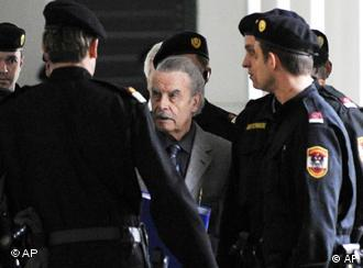 Josef Fritzl, center, is escorted to a break during the second day of his trial