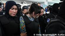 Vietnamese defendant Doan Thi Hong is escorted by police personnel at Kuala Lumpur airport (Getty Images/AFP/M. Rasfan)