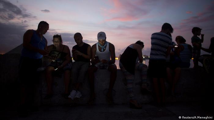 People connect to internet at hotspot in Cuba